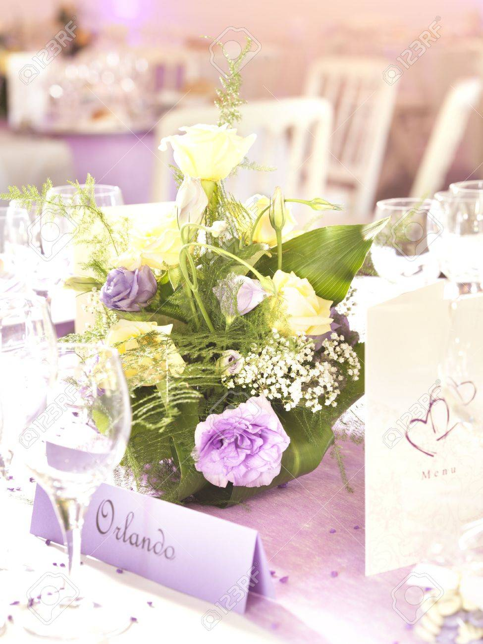 Wedding decoration with flowers and place card in yellow and stock stock photo wedding decoration with flowers and place card in yellow and violet junglespirit Images