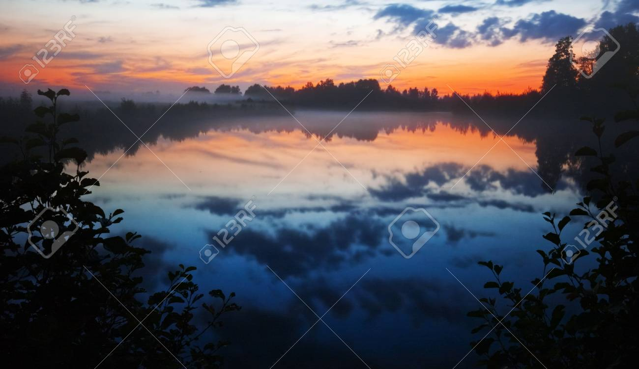 After sunset on the foggy lake Stock Photo - 8388506