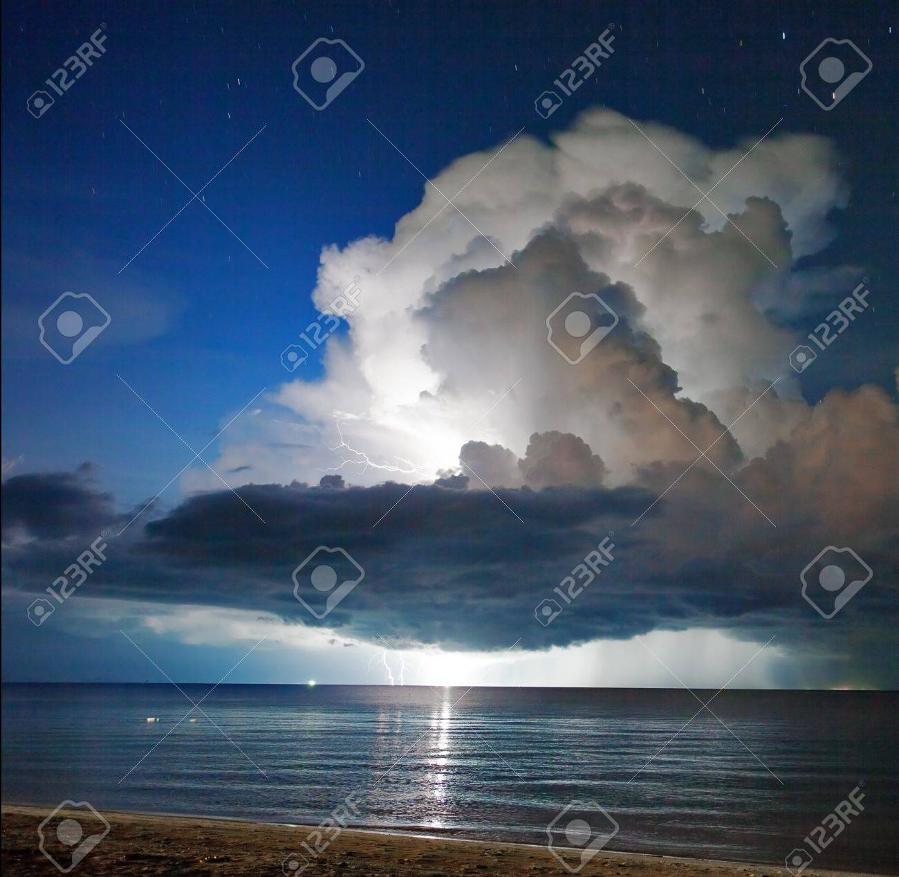 Lightning above the sea in tome of storm. Thailand Stock Photo - 10420818