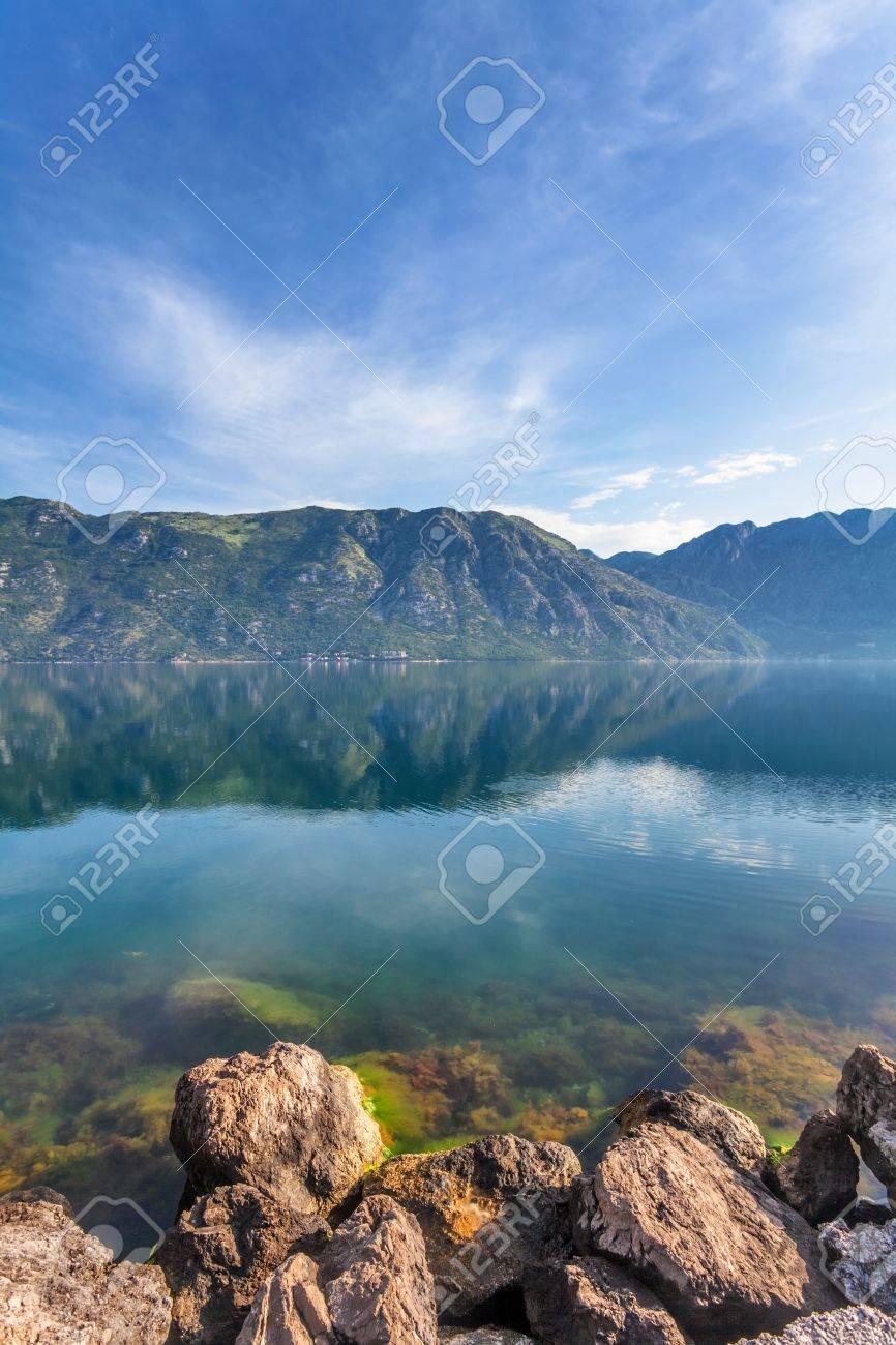 Stones beach with sea and mountain views   Montenegro Stock Photo - 15512698