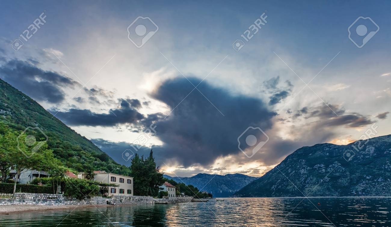 Gloomy sunset on the sea with the mountains  Montenegro Stock Photo - 16729252