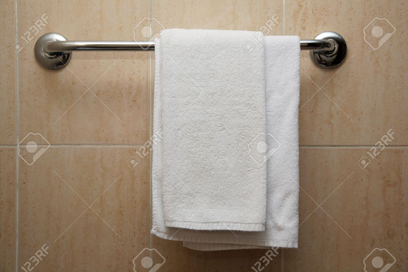 The towel hangs on a hanger in a bathroom Stock Photo - 3150331