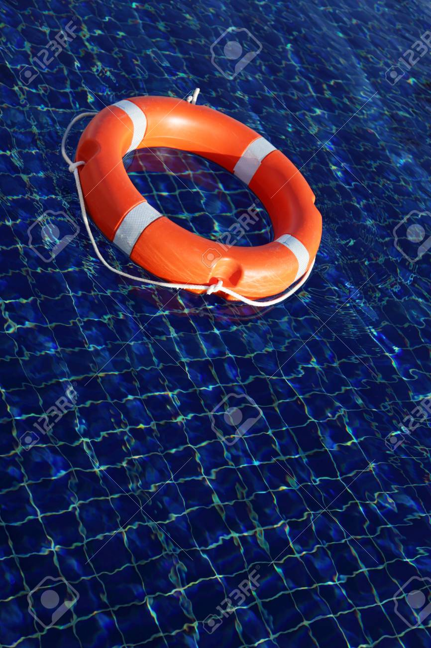 Red life buoy floating in swimming pool Stock Photo - 6031288