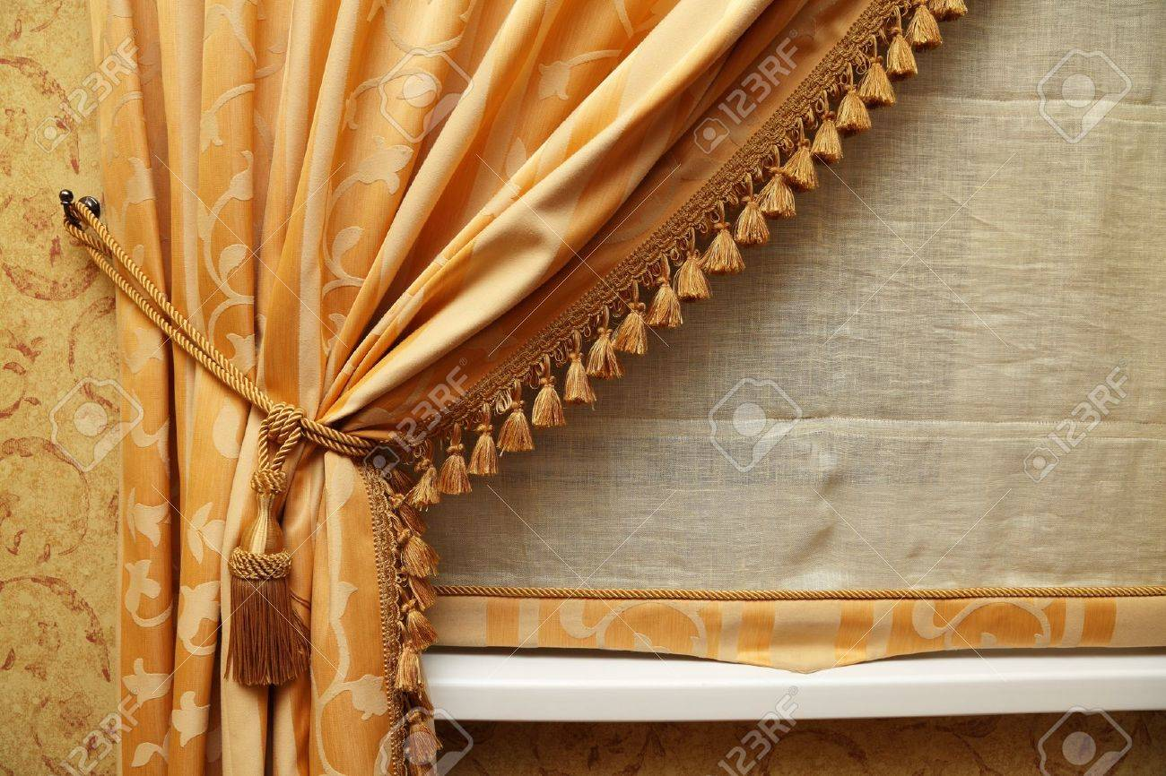fragment of a beautiful curtain of yellow color stock photo