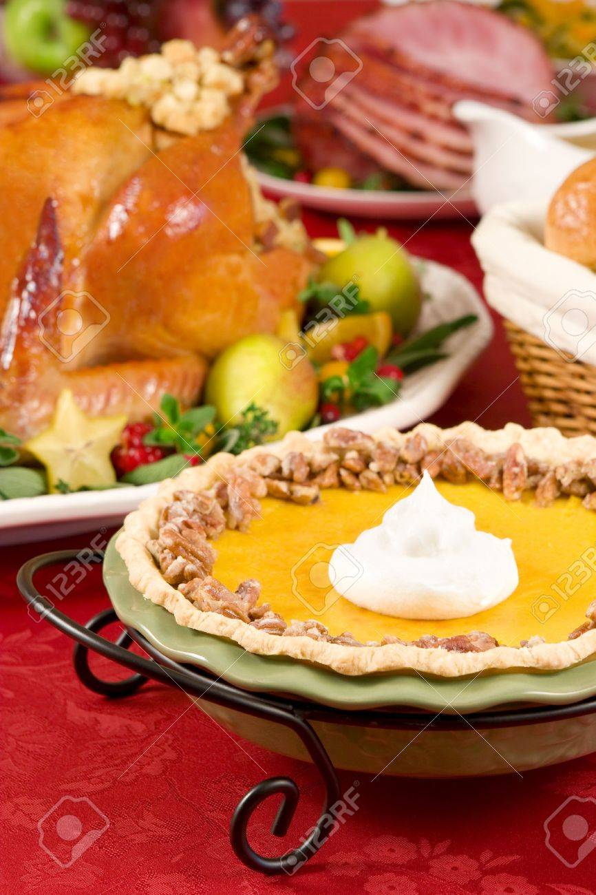 Pumpkin pie topped with pecans and cream Stock Photo - 1944884