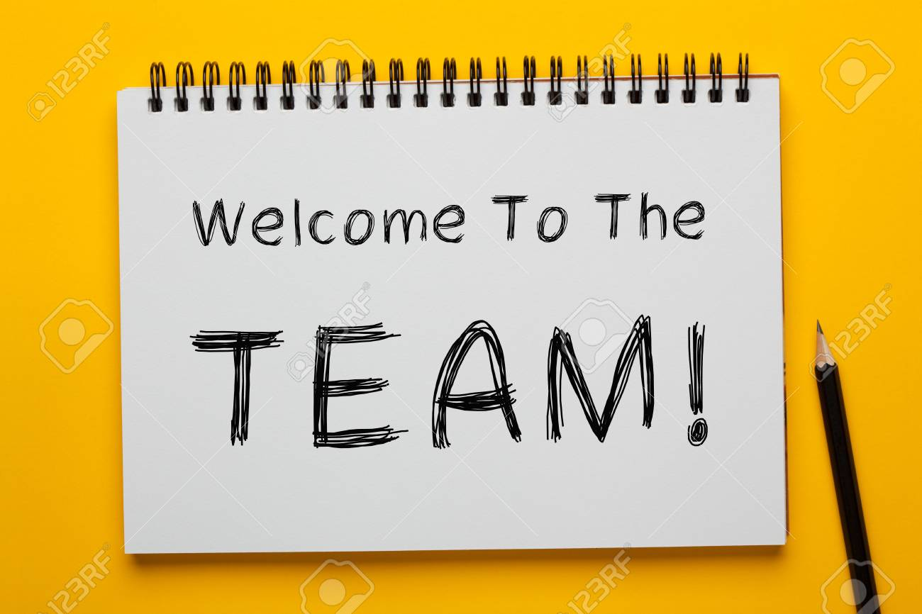 Welcome To The TEAM! written on notepad with pencil on yellow background. Business concept. - 109563014