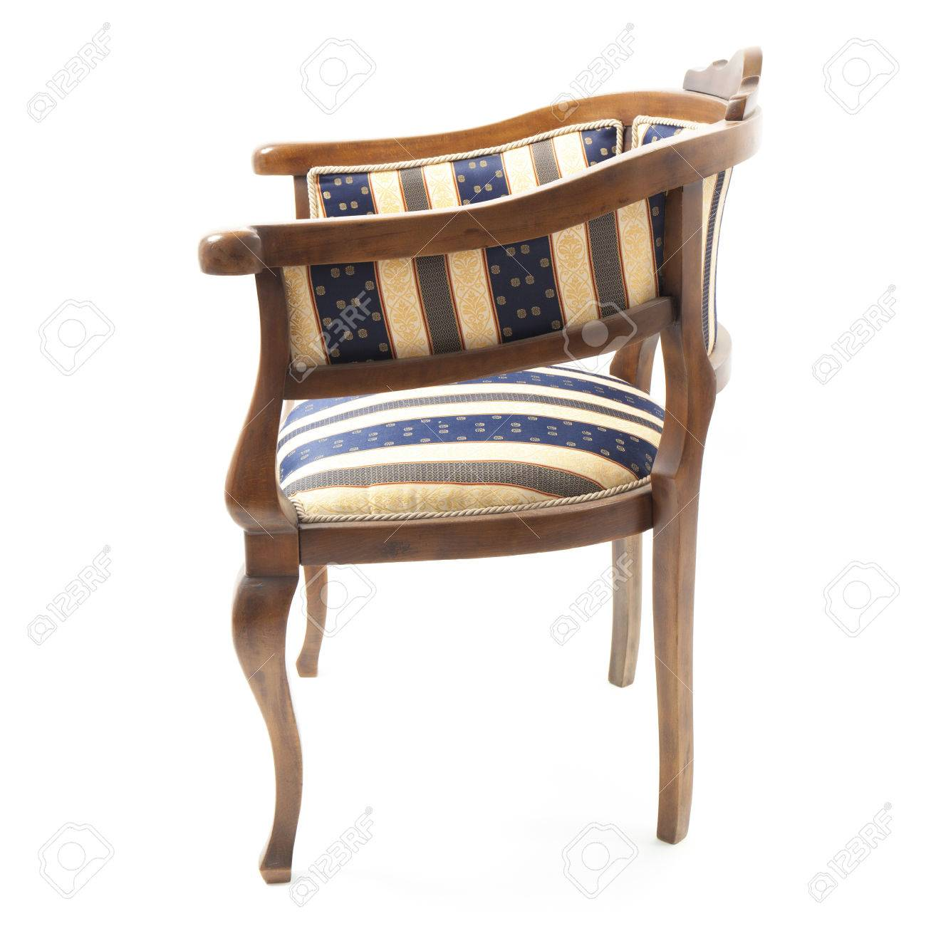 Retro Styled Armchair Upholstered In Striped Fabric. The Chair Is In The  Center Of A