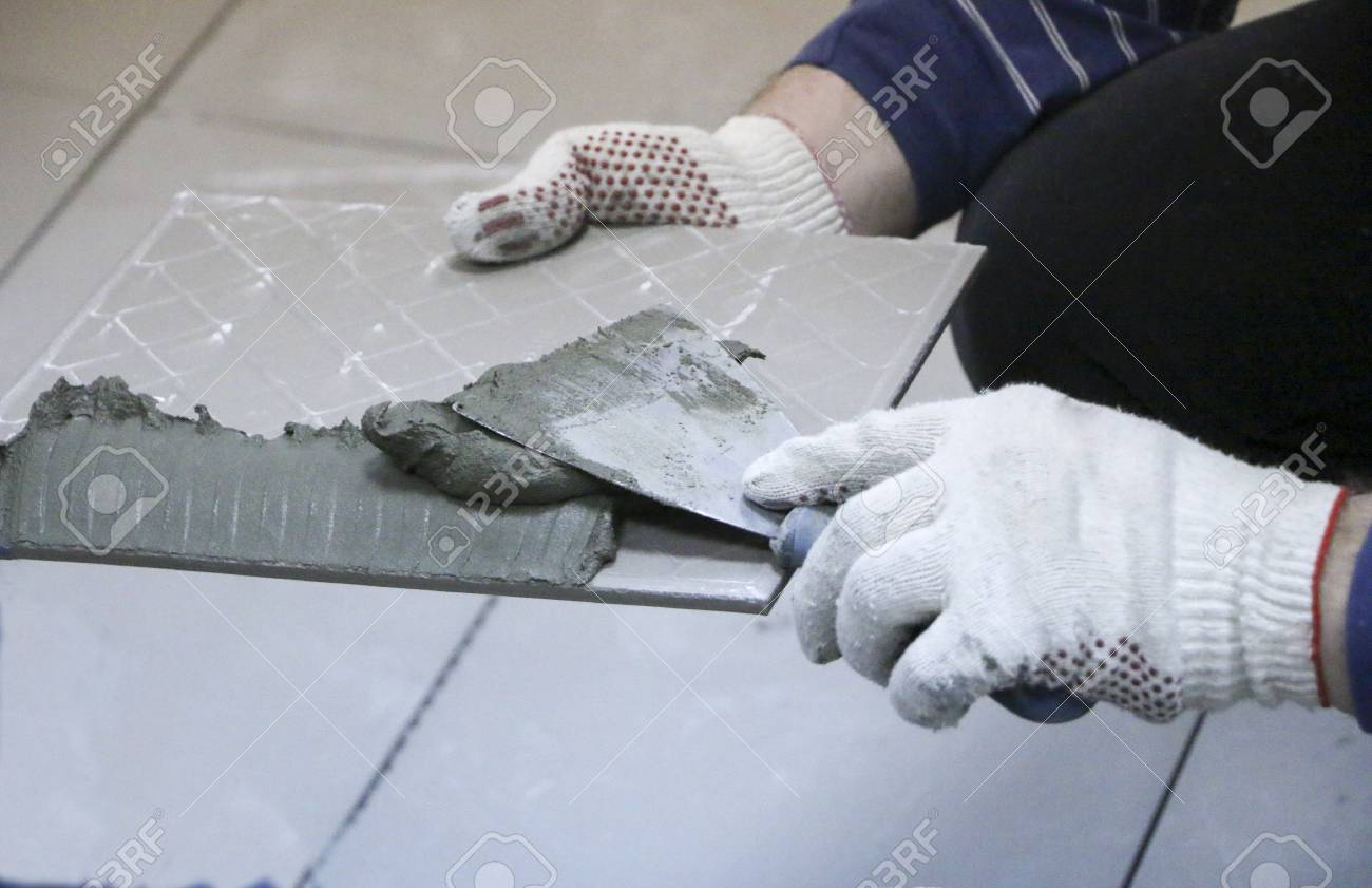 Repair Interior Decoration Laying Of Floor Ceramic Tiles Stock
