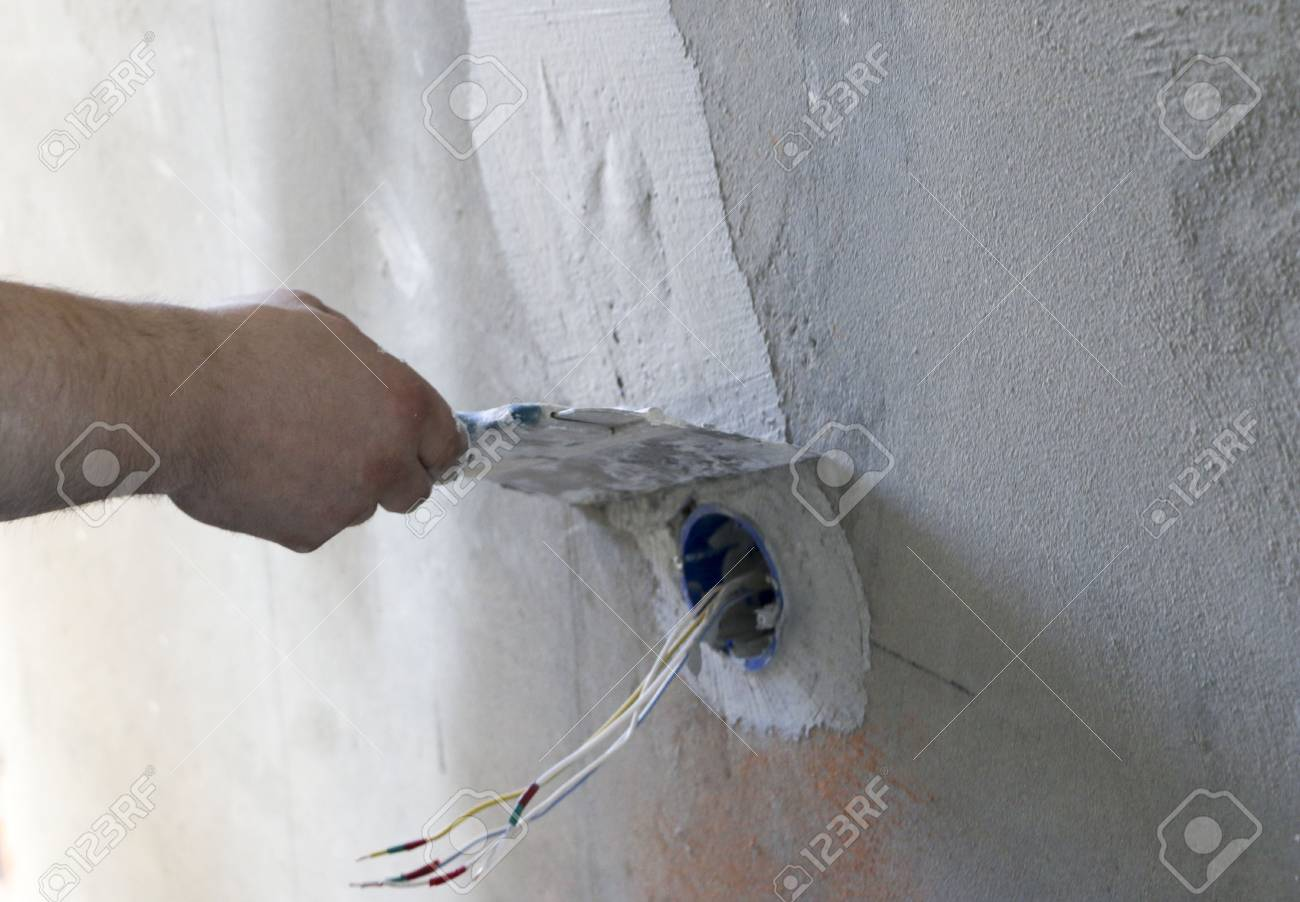 Wall Socket Installation Work On Installing Electrical Outlets Wiring For Stock Photo Electrician Prepares Fitting