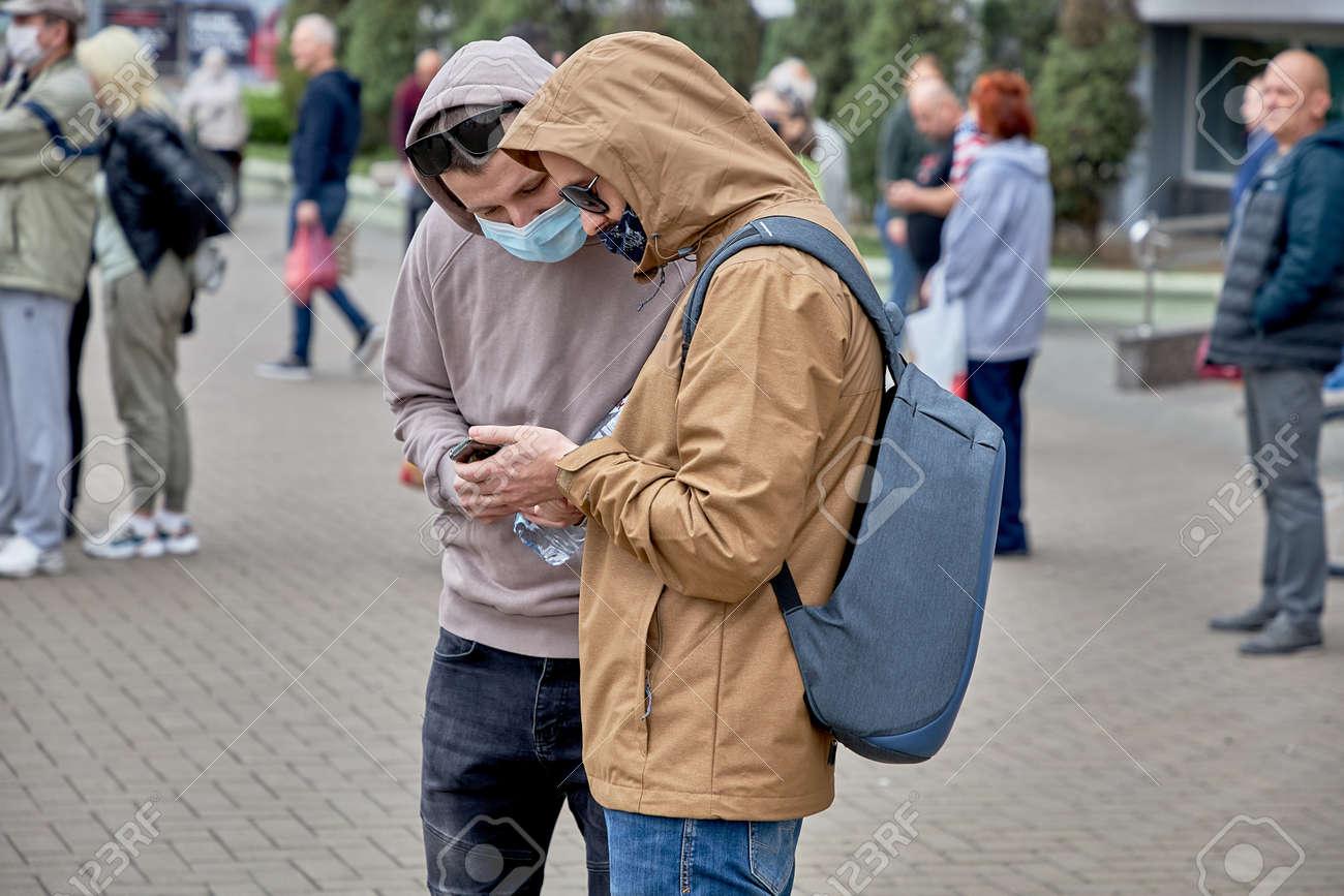 June 14 2020 Minsk Belarusian people walk down the street - 151081005