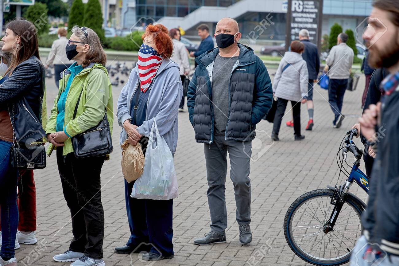 June 14 2020 Minsk Belarus An elderly woman in a mask of the color of the United States stands in line to leave signatures for possible presidential candidates - 151081488