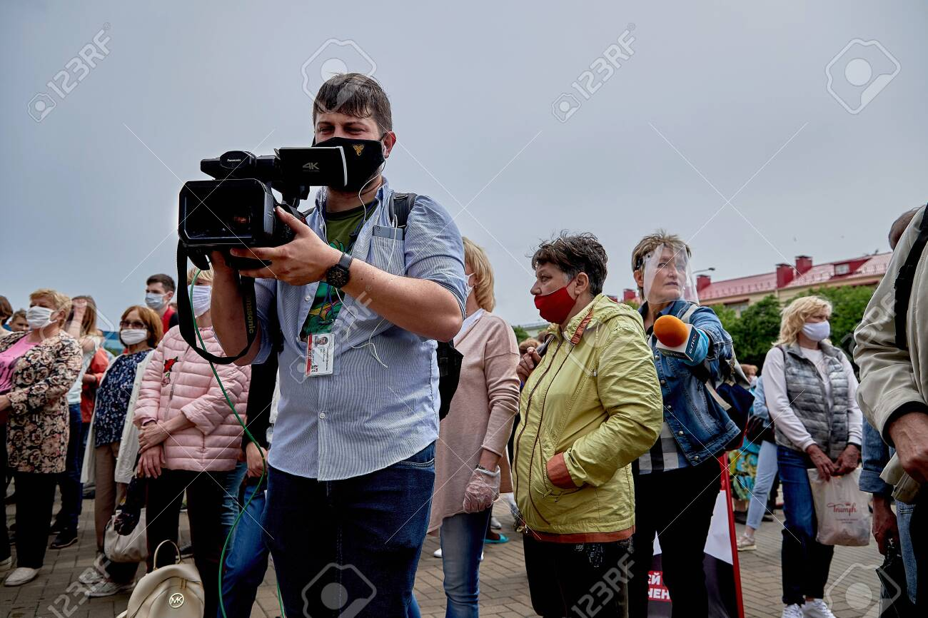 June 7 2020 Minsk Belarus A man with a large camera takes video of people at a protest rally - 151307342