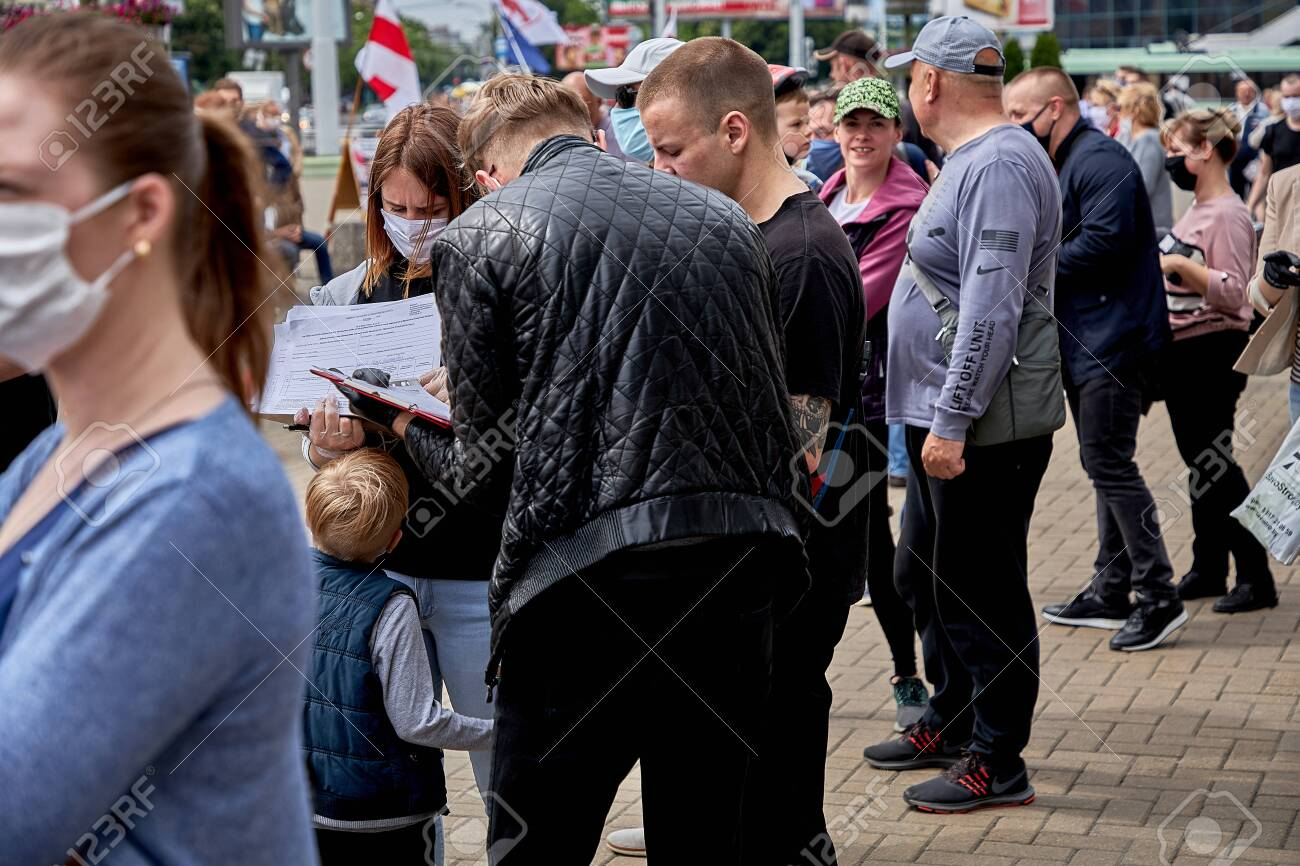 June 7 2020 Minsk Belarus A lot of masked people are standing in line and signing up for a possible presidential candidate - 151375734