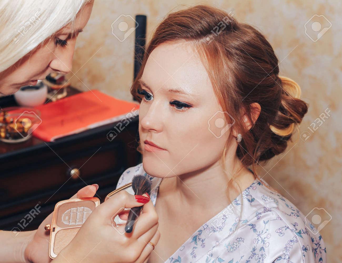 Minsk Belarus Makeup artist doing hairstyle to girl - 156649703