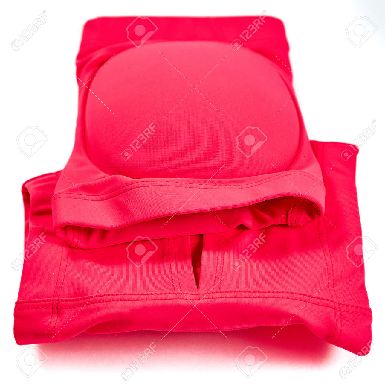 Knee pads for leg protection in rhythmic gymnastics lie on top of each other.The view from the top - 158725048