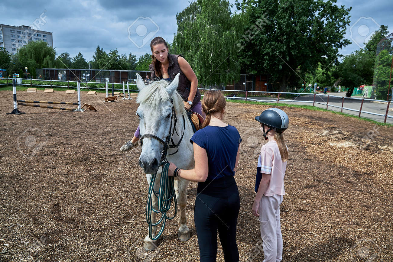 June 21 2020 Minsk Belarus A young teenage girl rides a horse - 165009946
