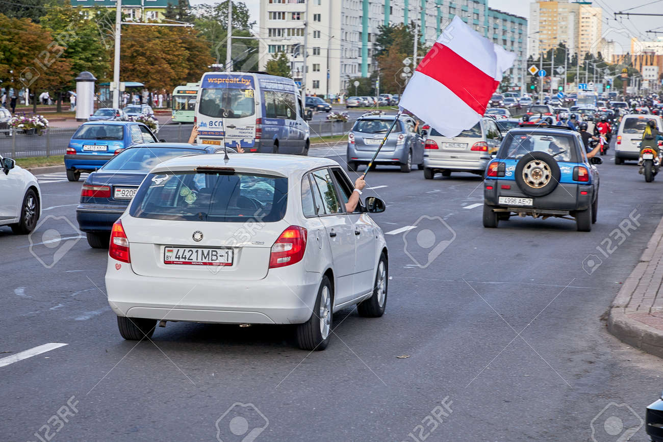 August 15 2020 Minsk Belarus A car with an opposition flag and a stop dictator poster - 166895005