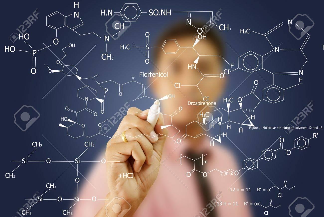 asian teacher writing scientific formula on the whiteboard stock
