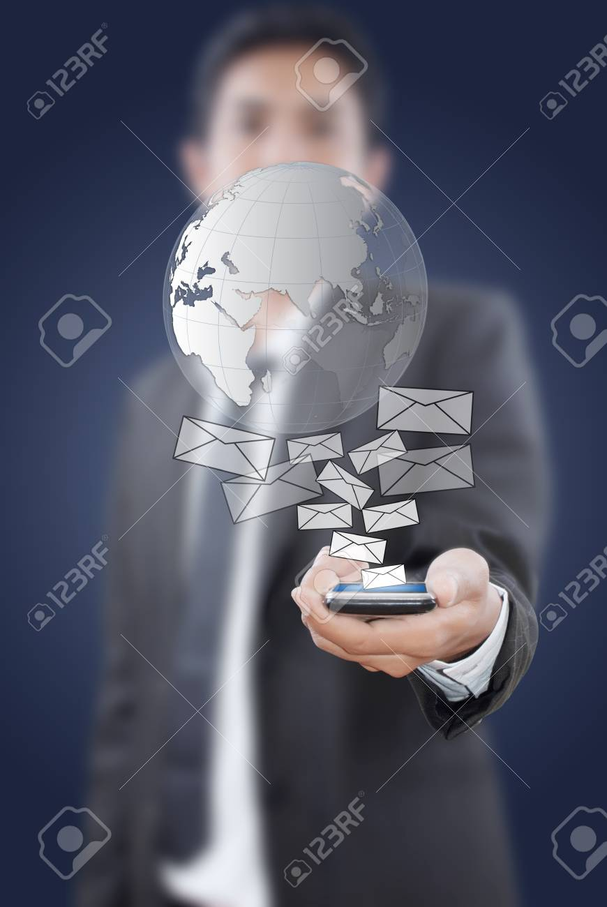 Businessman putting touch screen mobile phone with globe mail. Stock Photo - 10994334