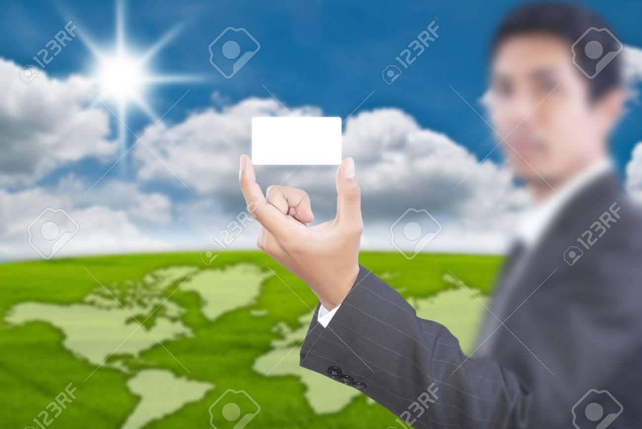 Asian businessman pushing white name card. Stock Photo - 11163724