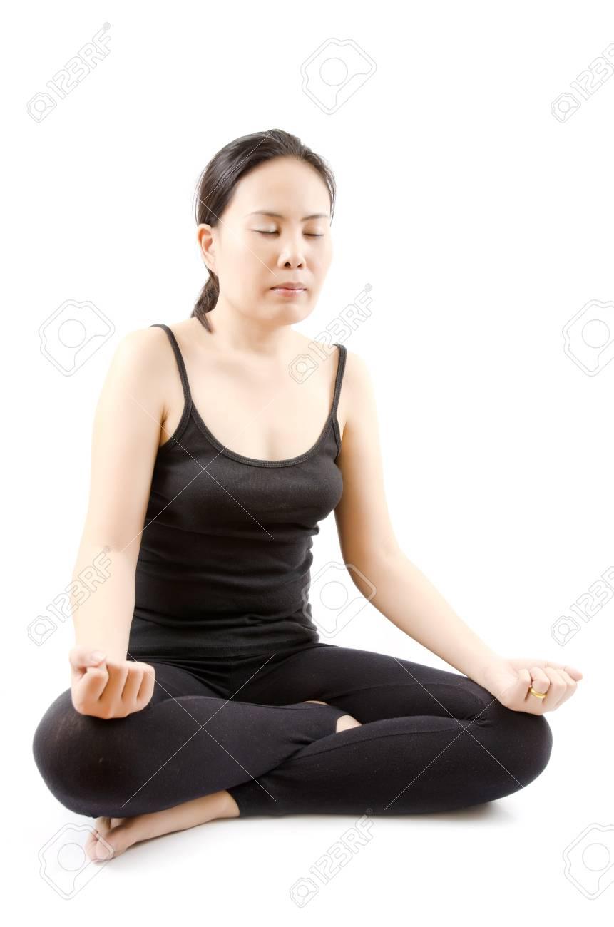 Young Asian woman doing yoga exercise Stock Photo - 13015360