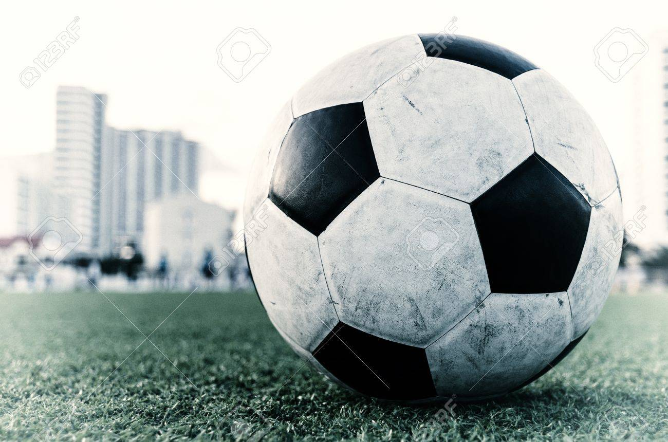 Vintage Soccer Football on the green grass of Soccer field with player playing soccer Stock Photo - 16394558