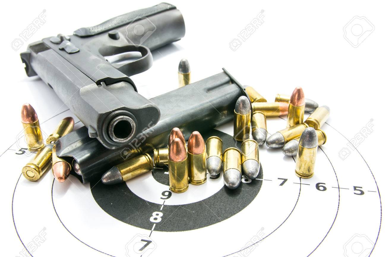 Gun and Bullets on shooting range Isolated on the white background. - 82508011