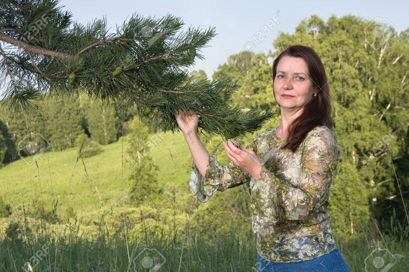Portrait of the woman with a pine branch Stock Photo - 7639679