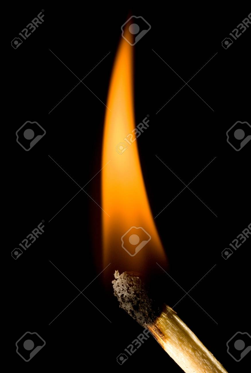 Burning match against a black background Stock Photo - 9779020
