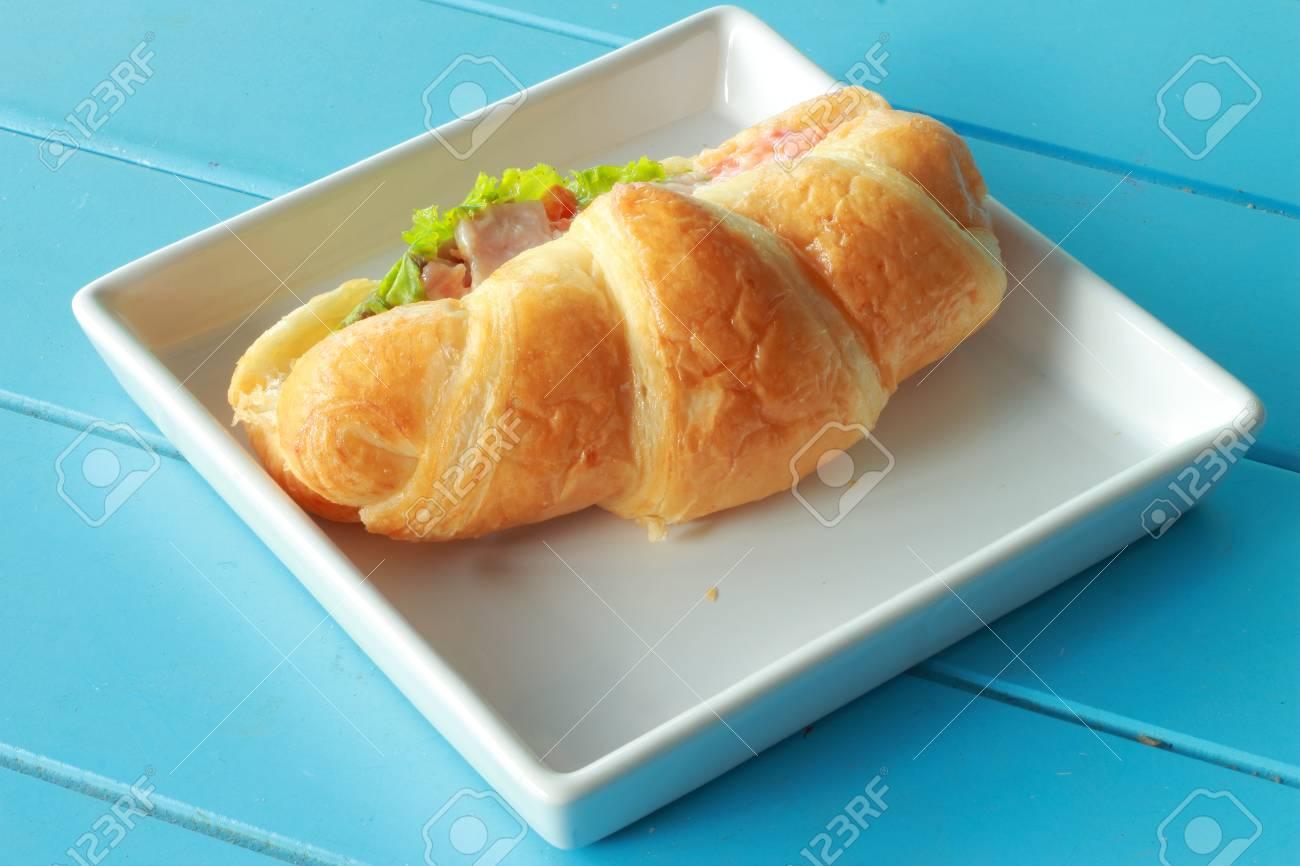 Bread croissants ham cheese white plate Stock Photo - 16527228