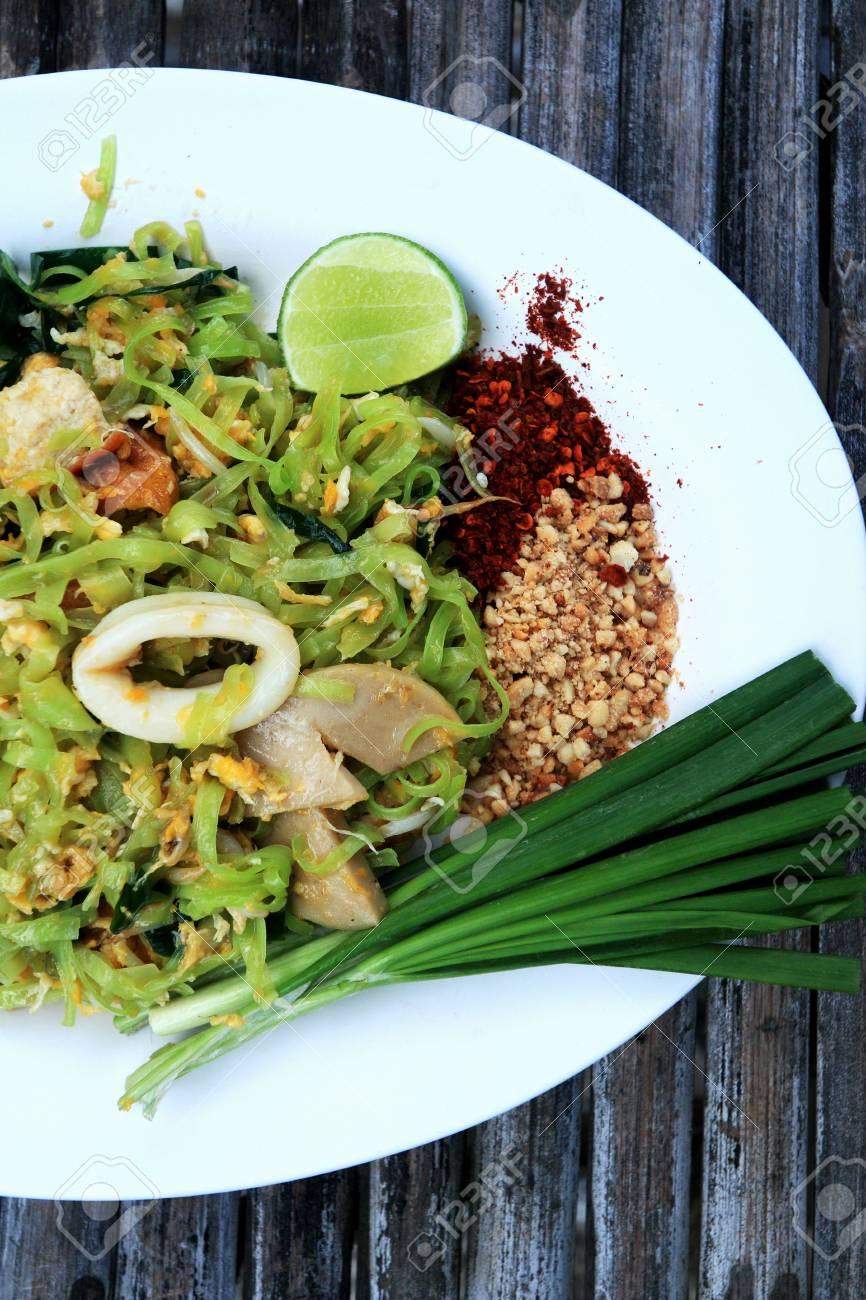 Stir-fried noodles, green lines put the squid and pork. Stock Photo - 24366772