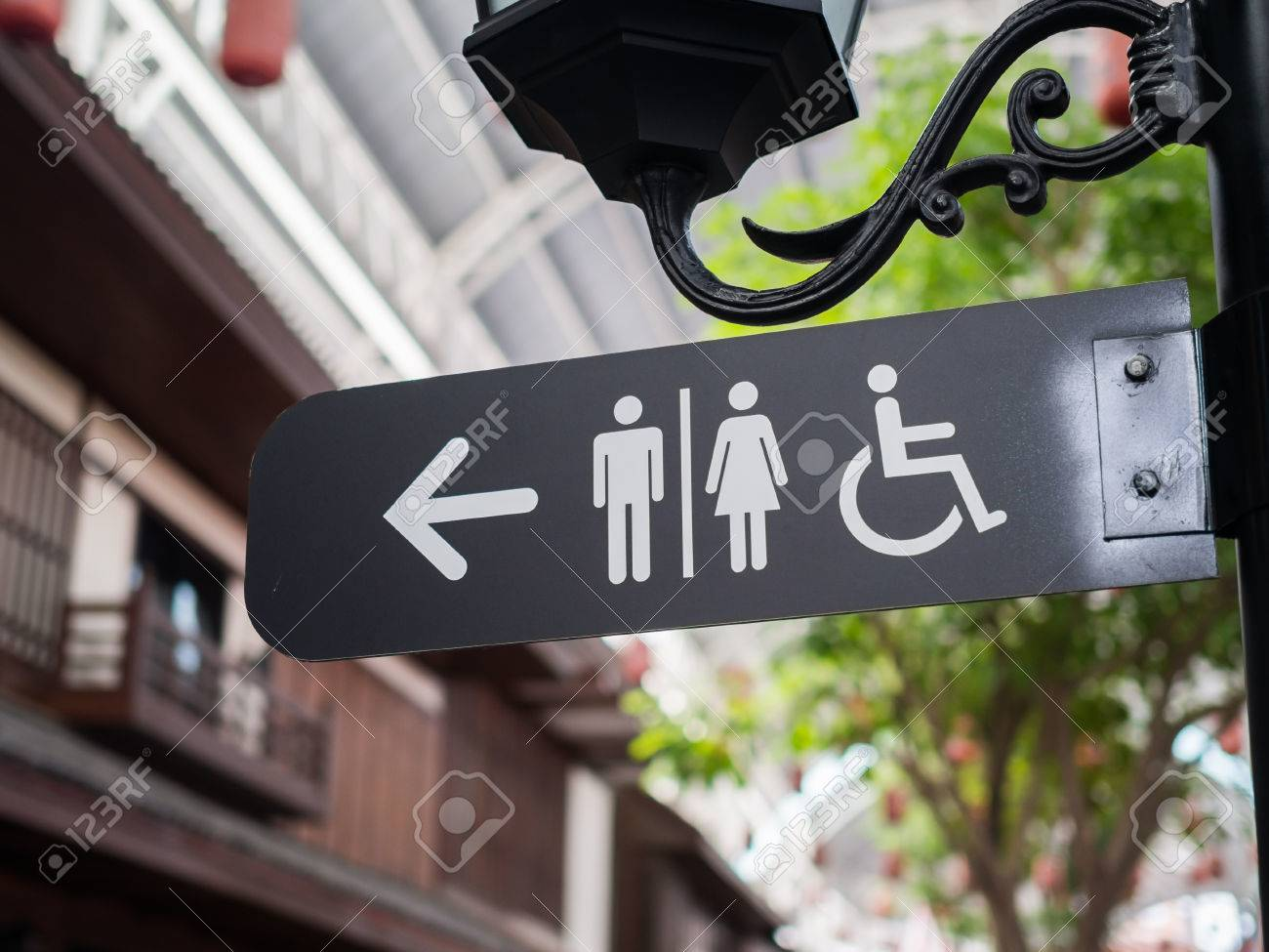 Public restroom signs with a disabled access symbol - 46172959