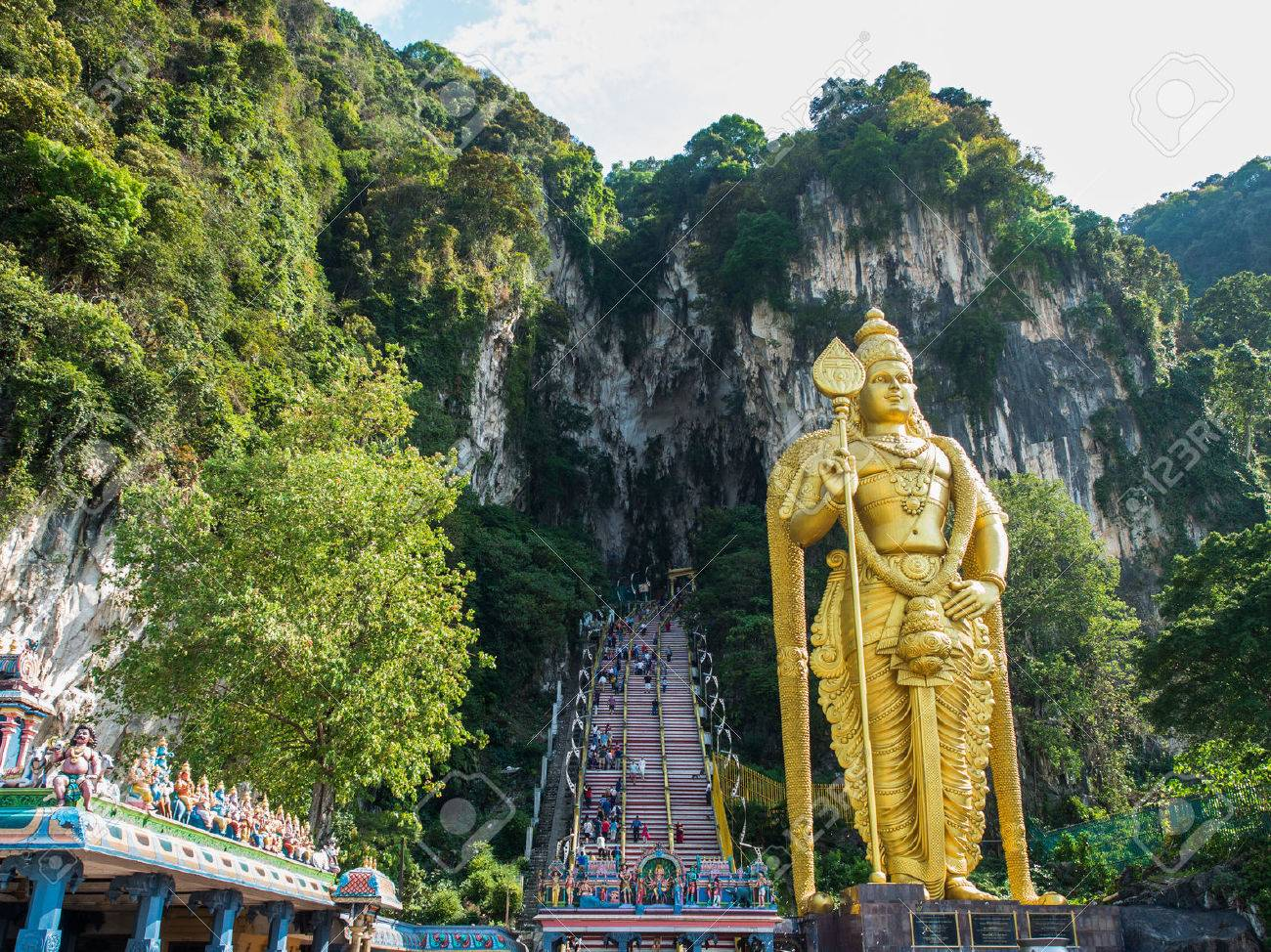 Tourist and Lord Murugan Statue in front the batu cave entrance - 61114619