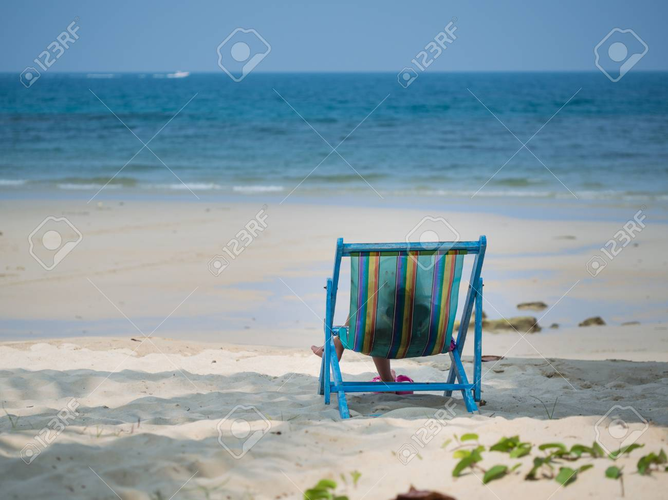 Kid sitting on beach chair and looking to the blue sea Stock Photo - 62265287 & Kid Sitting On Beach Chair And Looking To The Blue Sea Stock Photo ...