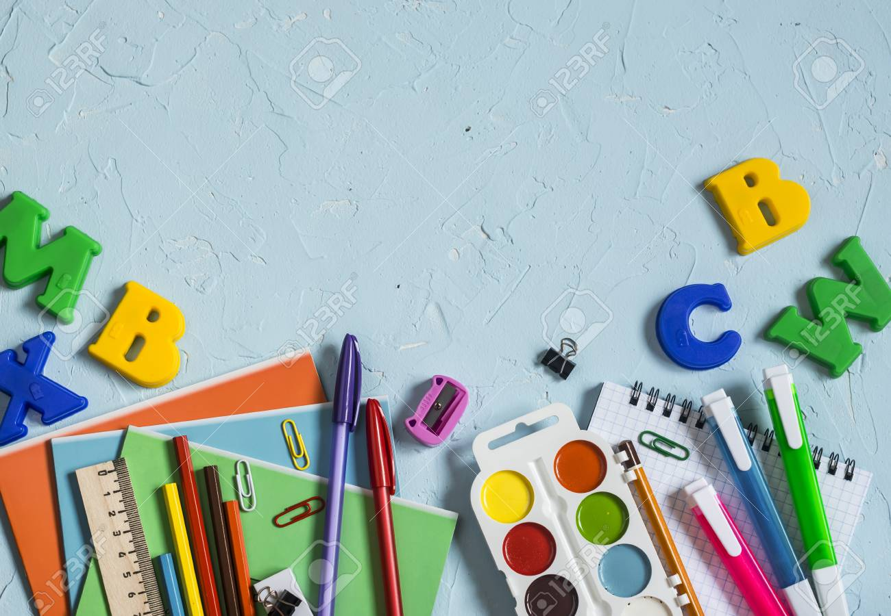 School supplies and accessories on a blue background  Free space