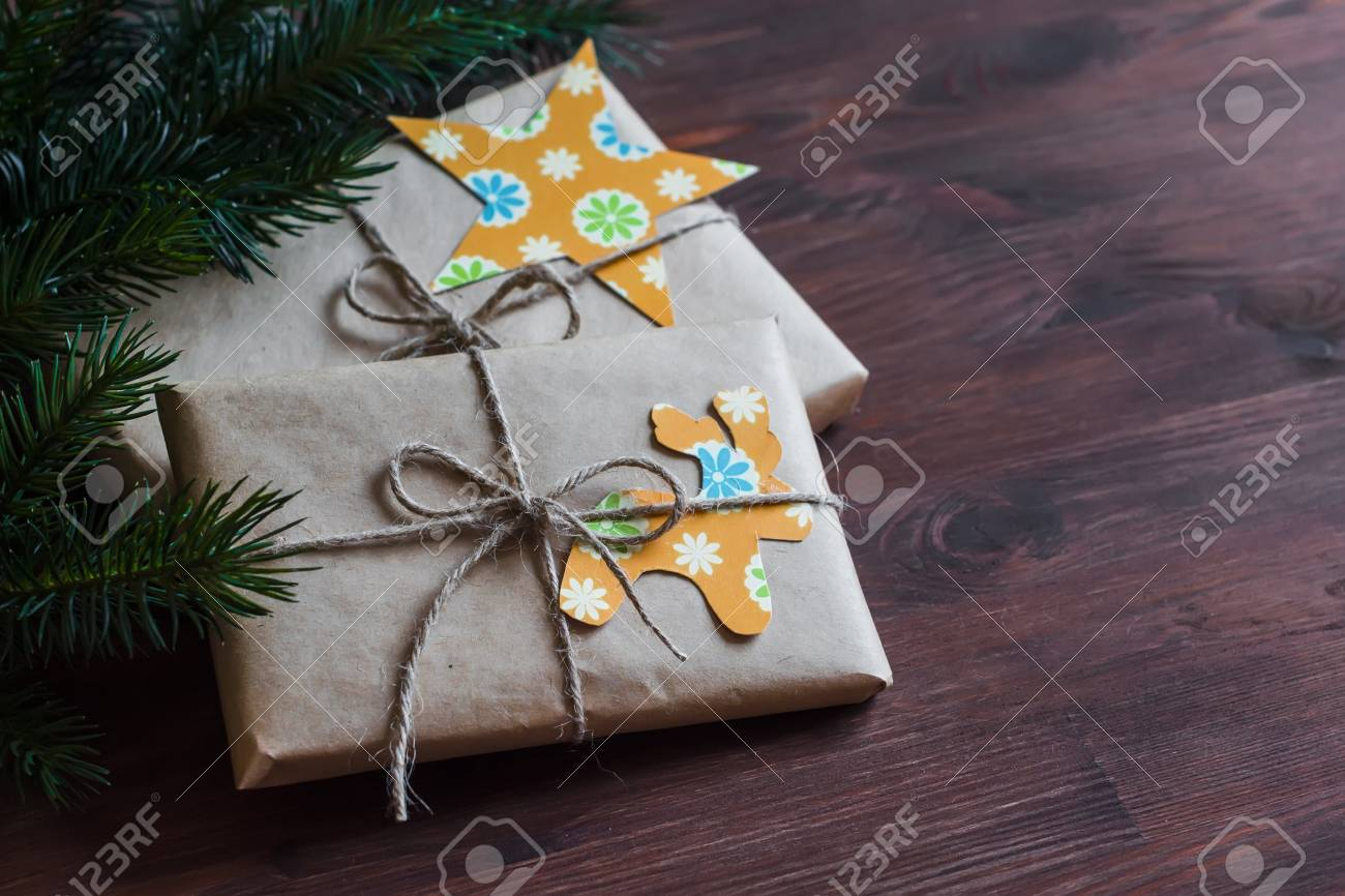 Homemade Christmas Gifts In Kraft Paper With Handmade Tags And ...