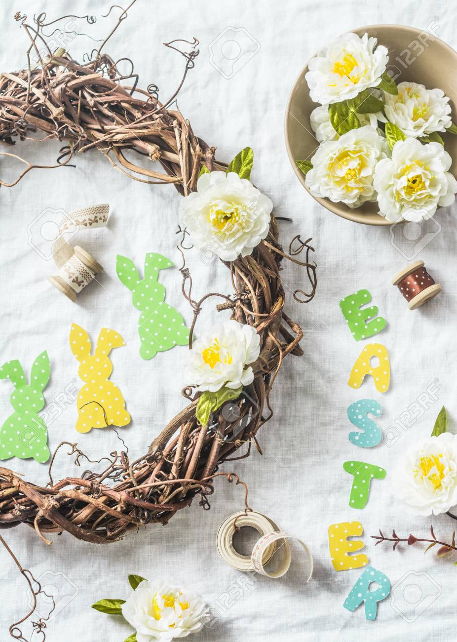 Making Homemade Easter Wreath Of Vines With Flowers Paper Rabbits