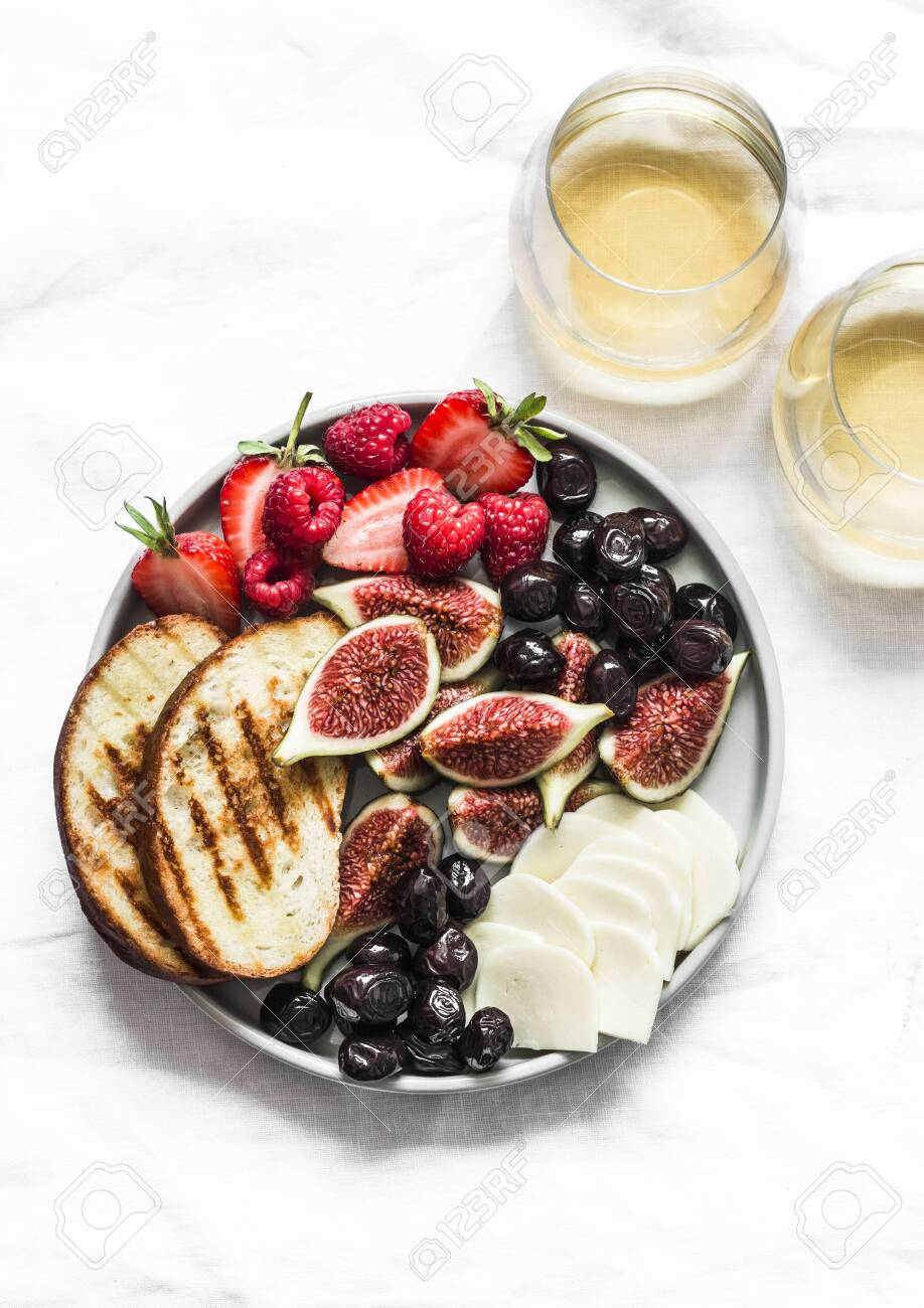Glasses Of White Wine And Snack Appetizers Tapas Plate With Cheese Stock Photo Picture And Royalty Free Image Image 136483670