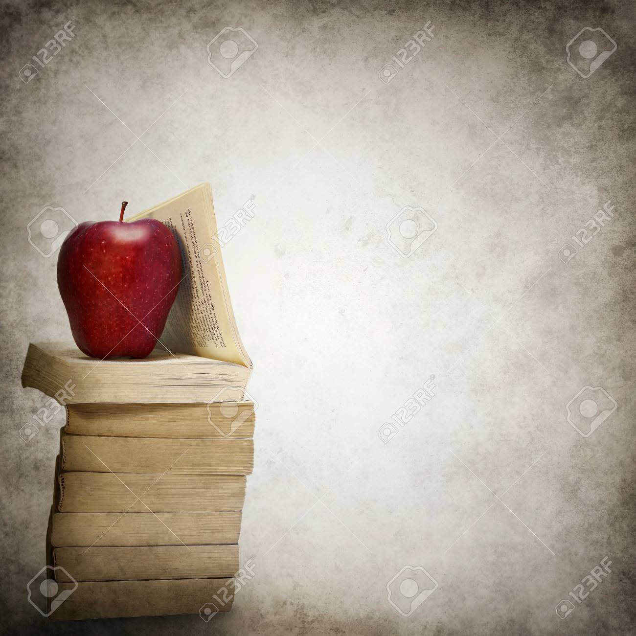 Grunge background with stack of books and red apple Stock Photo - 25131055