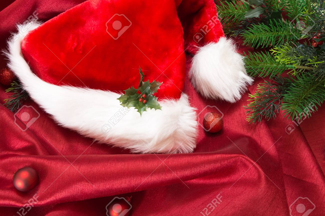 Santa S Hat With Christmas Ornaments On Red Wavy Fabric