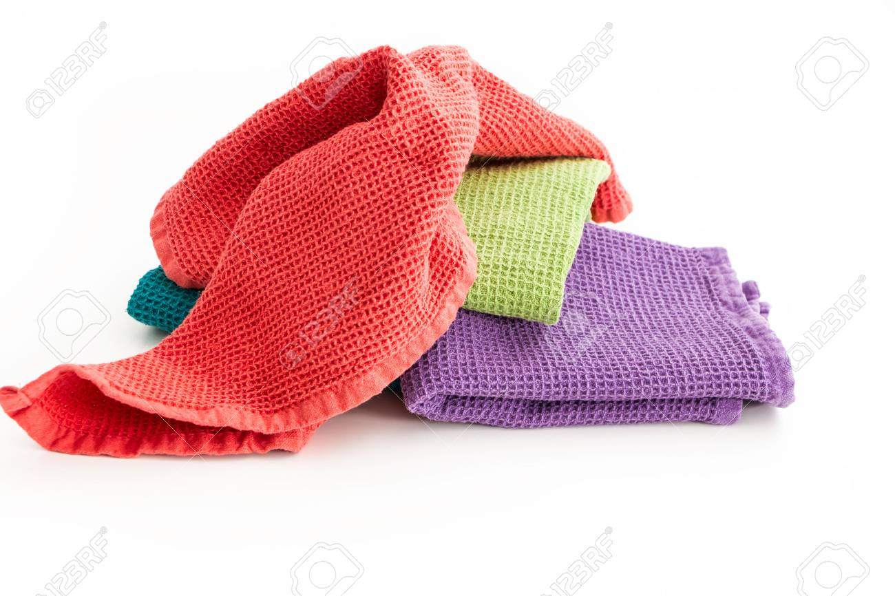 Pile Of Messy And Folded Colorful Kitchen Towels On White Background Stock Photo Picture And Royalty Free Image Image 91284569