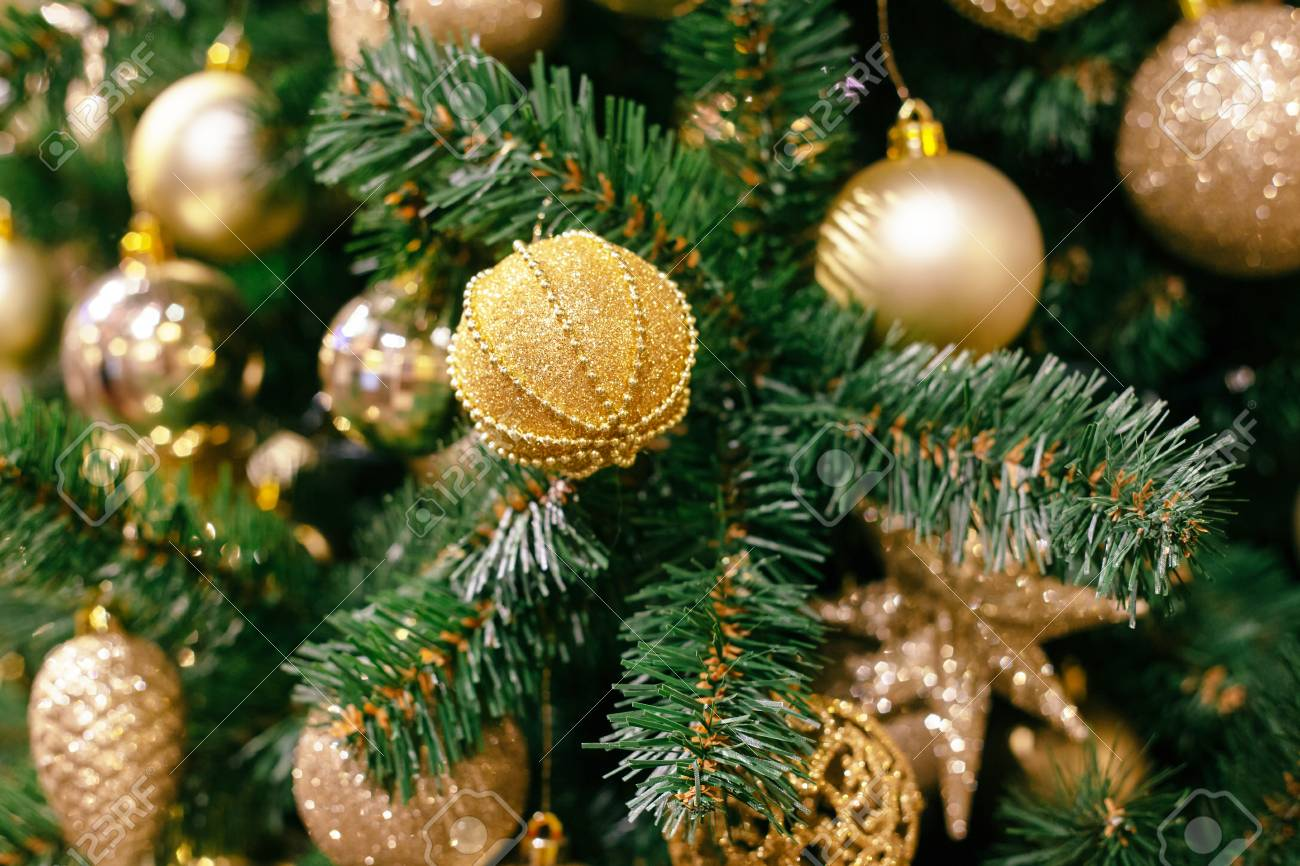 Closeup Of Christmas Tree Background With Golden Balls Stock Photo
