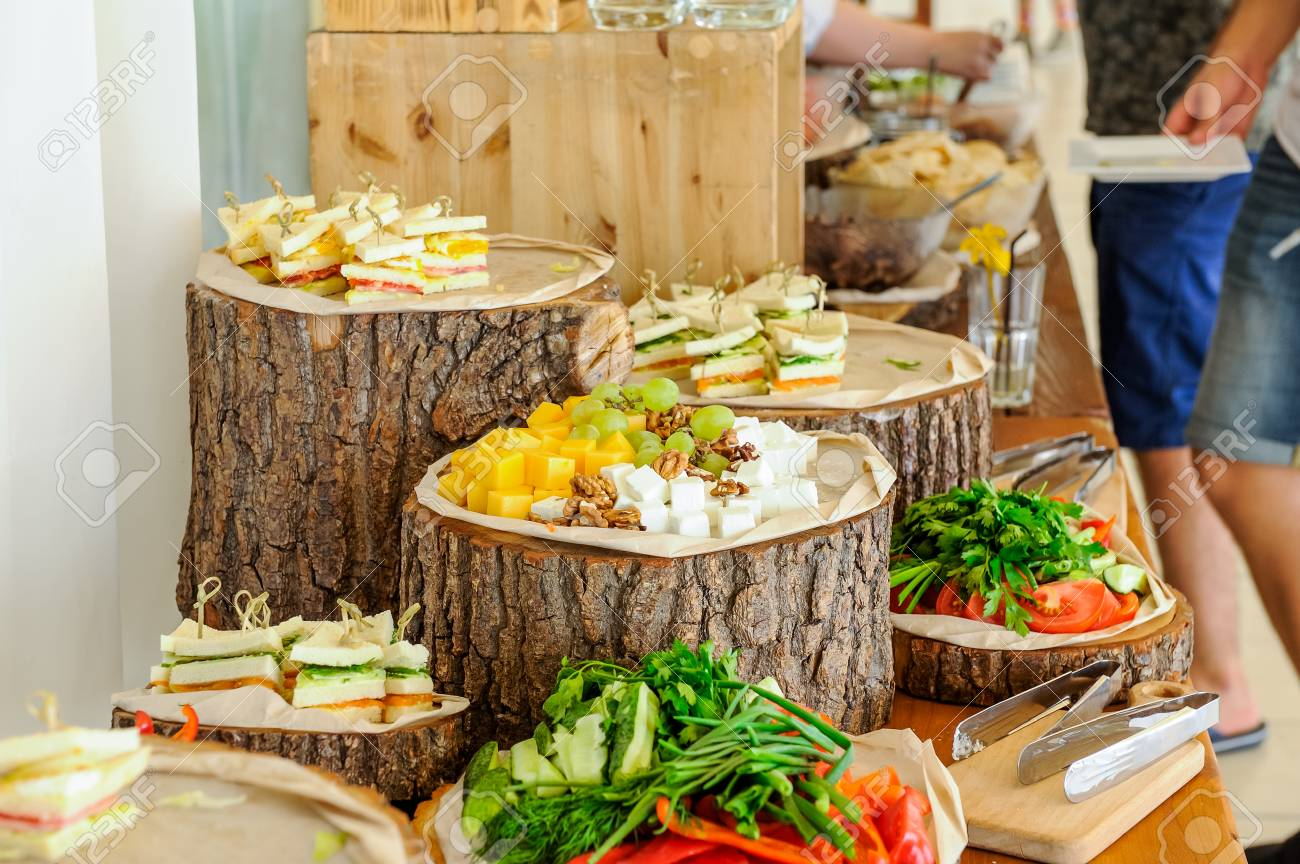 Outside Catering Buffet Table With A Delicious Food For Guests Of The Event In Rustic Style