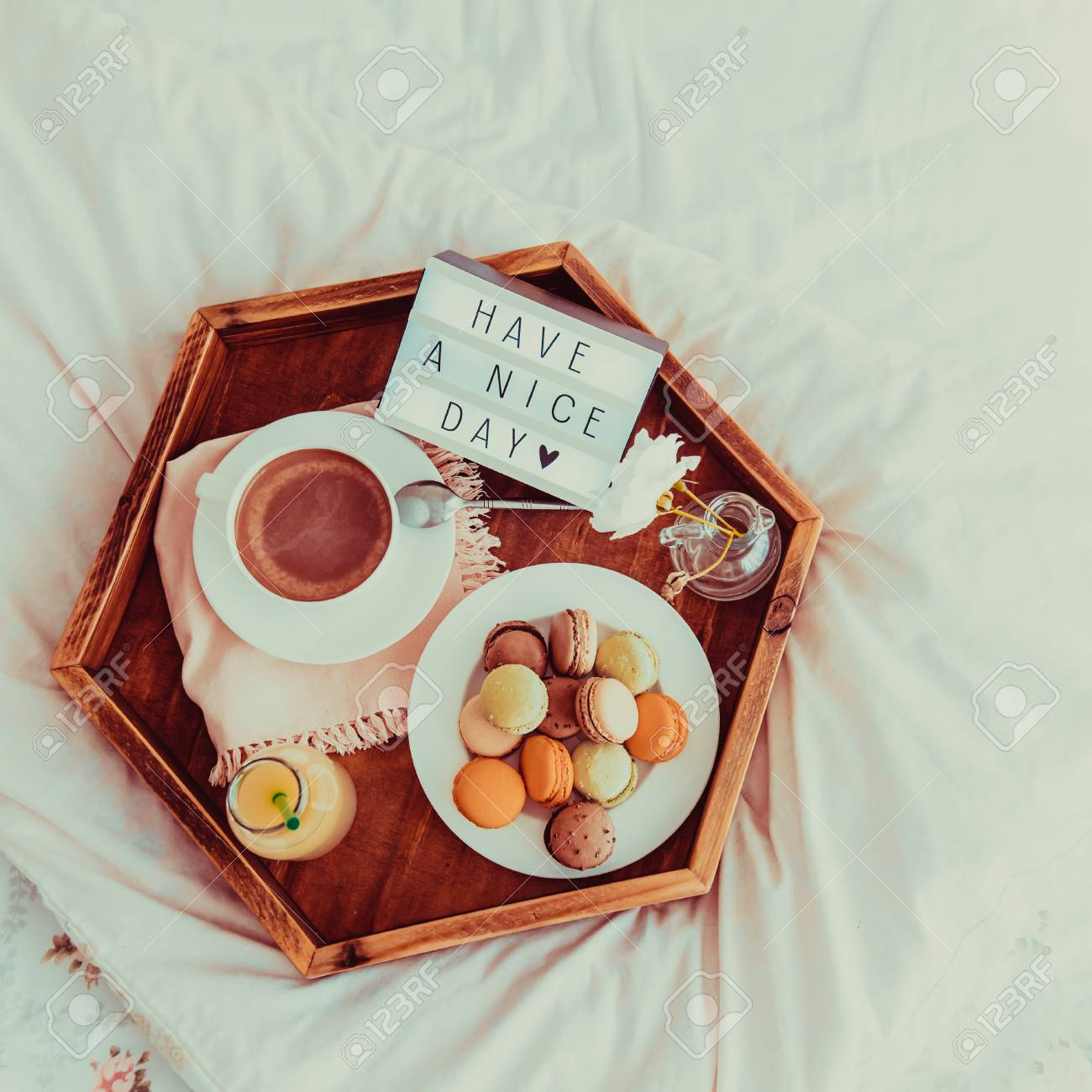 Top View Breakfast In Bed With Have A Nice Day Text On Lighted Box