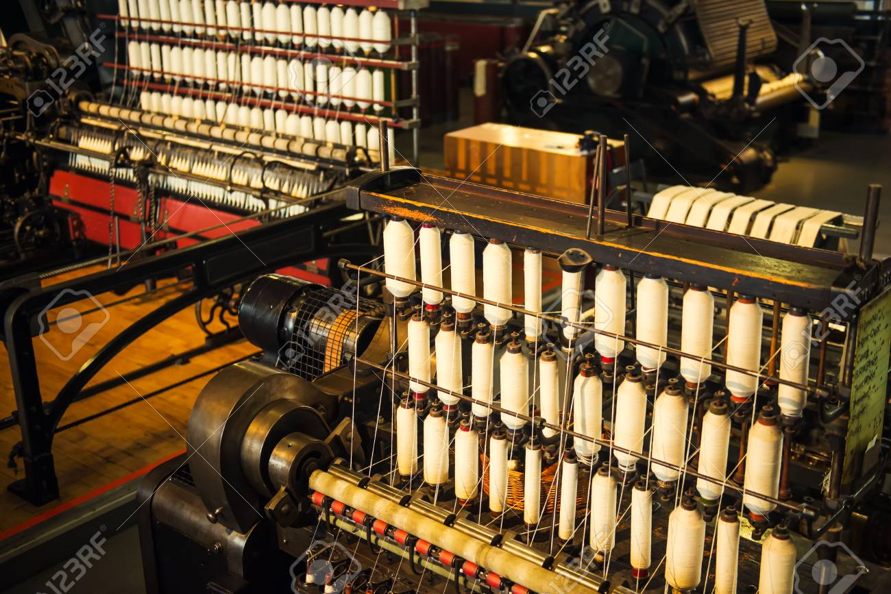 Rows of white cotton threads on vintage automatic loom  The concept