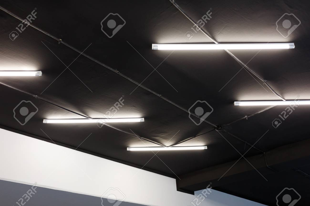 Led tube lights on black office ceiling minimal loft design stock led tube lights on black office ceiling minimal loft design stock photo 97025016 aloadofball Image collections