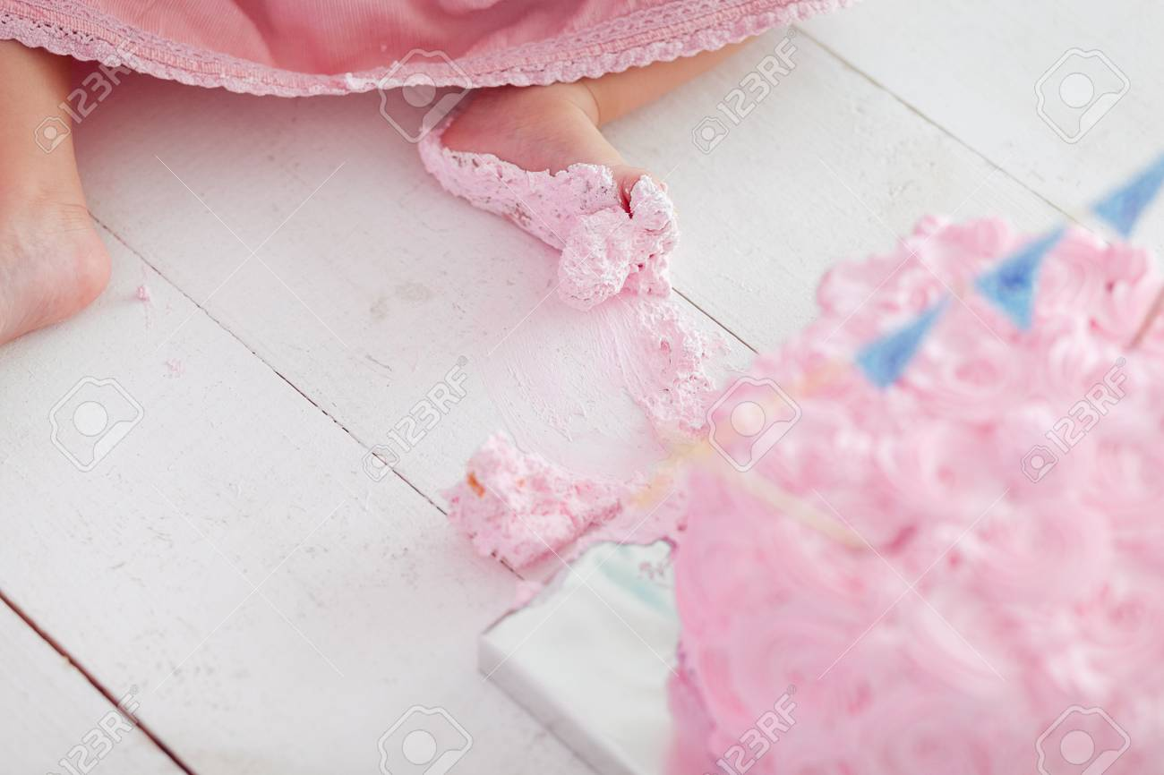 Dirty Baby Feet On White Wooden Floor Background First Birthday