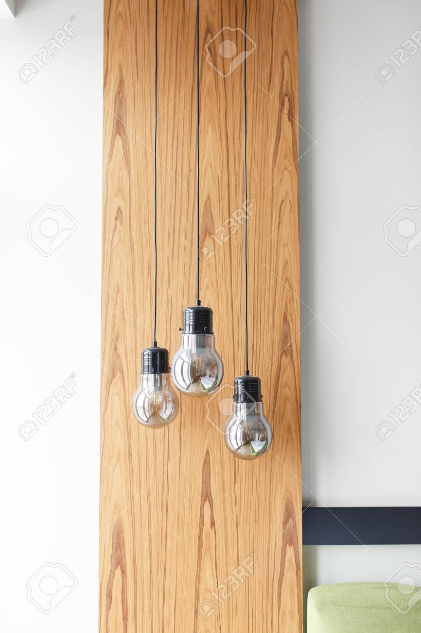 Light Bulbs On Wooden Panel Background Isolated On White Wall ...