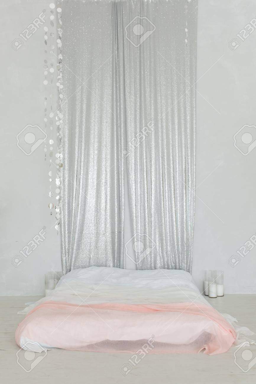 Minimalist Bedroom With Double Bed On Floor And Silver Curtain Stock Photo Picture And Royalty Free Image Image 101534149