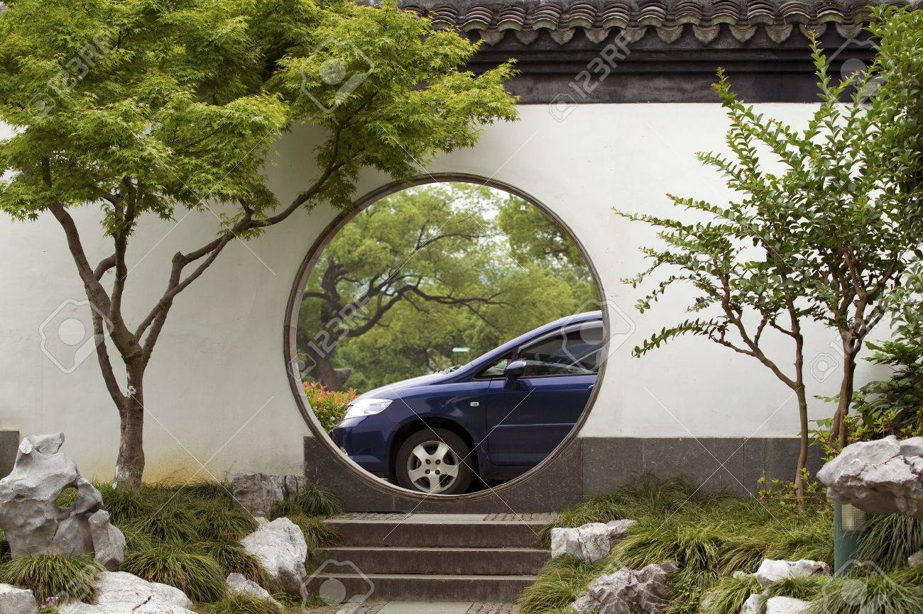 Traditional Chinese Garden Doorway And Modern Car China Stock Photo